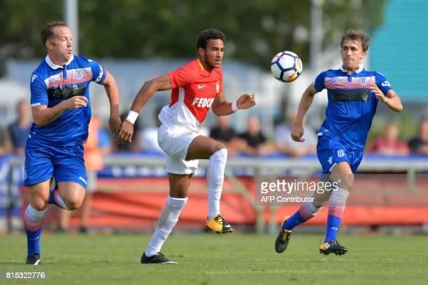Monaco's Spanish forward Jordi Mboula vies for the ball with Stoke City's Scotish midfielder Charlie Adams and Stoke City's Spanish defender Marc...