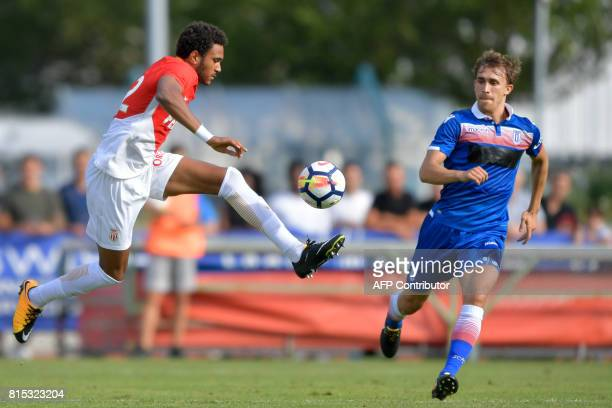 Monaco's Spanish forward Jordi Mboula vies for the ball with Stoke City's Spanish defender Marc Muniesa during a friendly football match between AS...