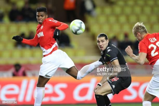 Monaco's Spanish forward Keita Balde Angers' French forward Enzo Crivelli and Monaco's Polish defender Kamil Glik go for the ball during the French...
