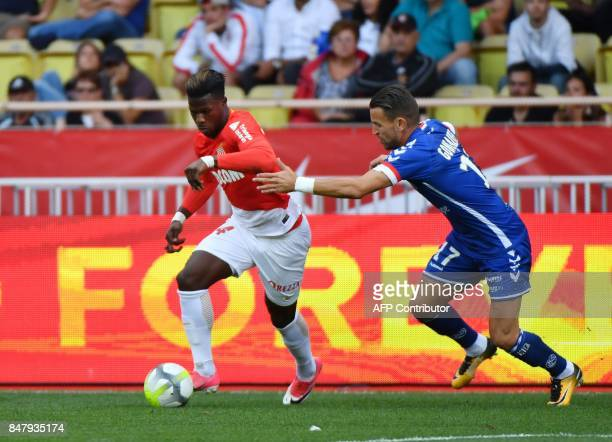 Monaco's Spanish forward Keita Balde fights for the ball with Strasbourg's French midfielder Anthony Goncalves during the French L1 football match...
