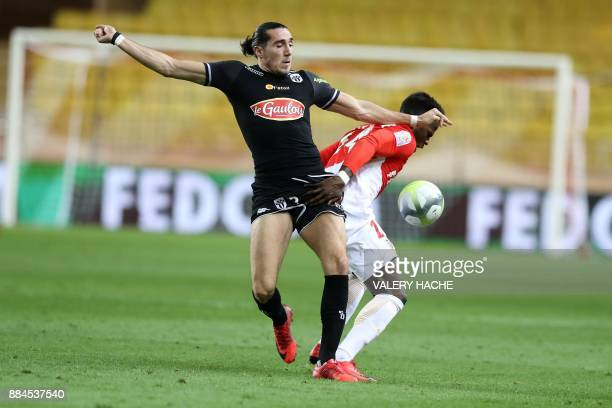 Monaco's Spanish forward Keita Balde vies with Angers' French forward Enzo Crivelli during the French L1 football match Monaco vs Angers on December...