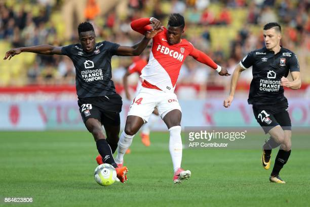 Monaco's Spanish forward Keita Balde vies with Caen's Haitian defender Romain Genevois during the French L1 football match Monaco vs Caen on October...