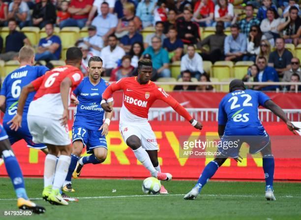 Monaco's Spanish forward Keita Balde vies with Strasbourg's French defender Ernest Seka during the French L1 football match Monaco vs Strasbourg on...