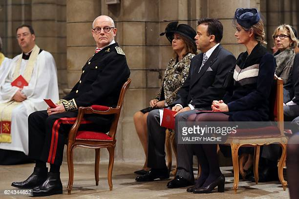 Monaco's State Minister Serge Telle and French journalist Guilaine Chenu attend a mass at the Saint Nicholas cathedral during the celebrations...