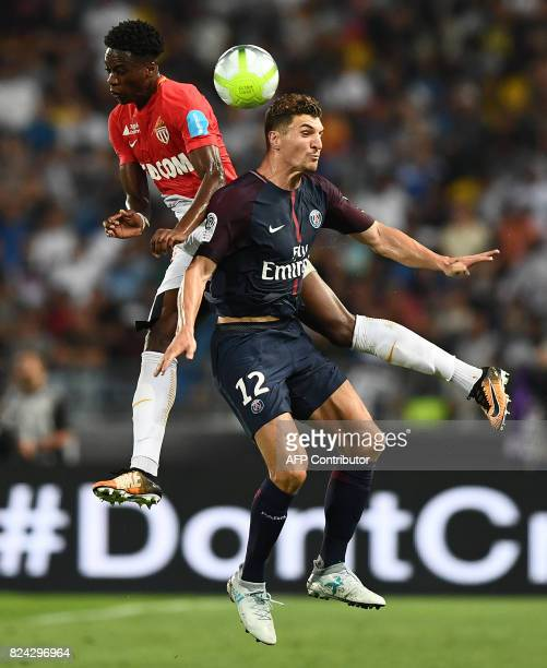 Monaco's Swiss defender Terence Kongolo and Paris SaintGermain's Belgian defender Thomas Meunier head teh ball during the French Trophy of Champions...