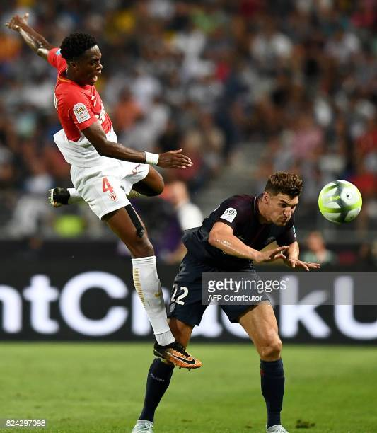 Monaco's Swiss defender Terence Kongolo and Paris SaintGermain's Belgian defender Thomas Meunier head the ball during the French Trophy of Champions...