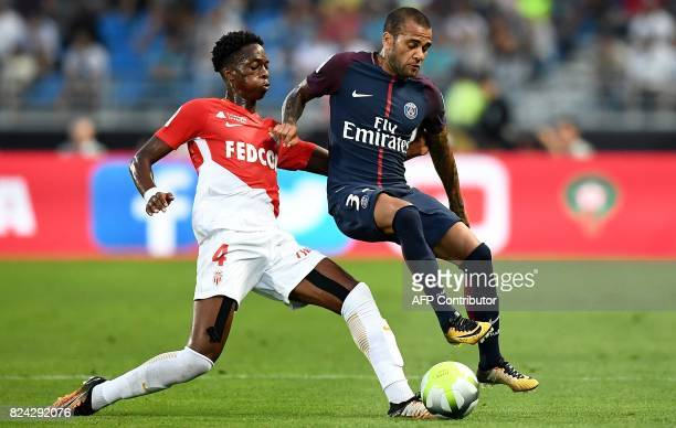 Monaco's Swiss defender Terence Kongolo vies with Paris SaintGermain's Brazilian defender Dani Alves during the French Trophy of Champions football...