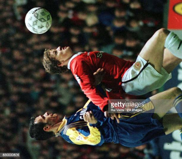 Monaco's Willy Sagnol puts presure on Manchester United's Ole Gunnar Solskjer at Old Trafford Tonight during their Champions' League quarterfinal 2nd...