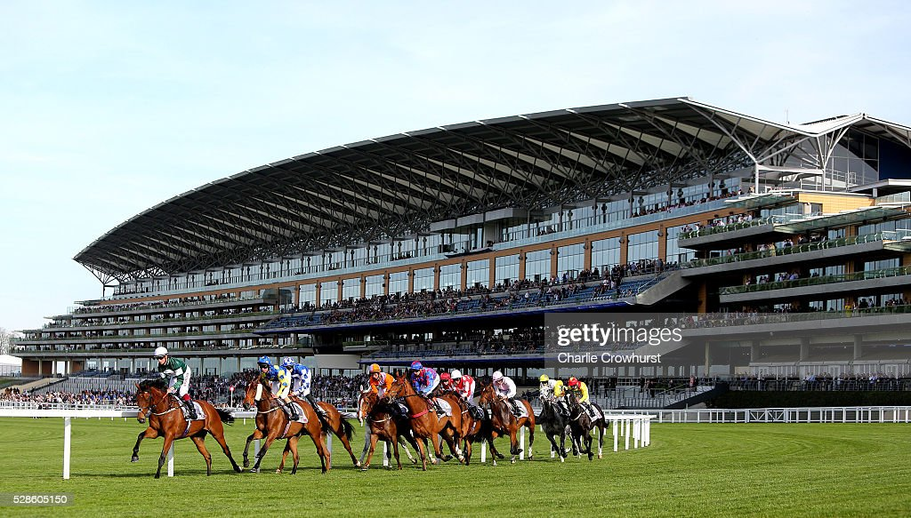 M M Monaghan on Shades of Silver leads the field past the Grandstand in The Time + Apprentice Handicap Stakes at Ascot racecourse on May 06, 2016 in Ascot, England.