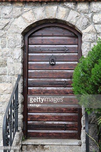 monastery gate, a narrow door the lattice : Stock Photo