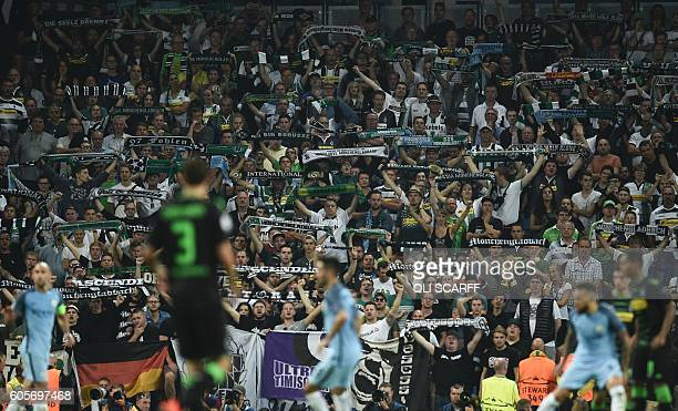 Monchengladbach fans hold up scraves during the UEFA Champions League group C football match between Manchester City and Borussia Monchengladbach at...