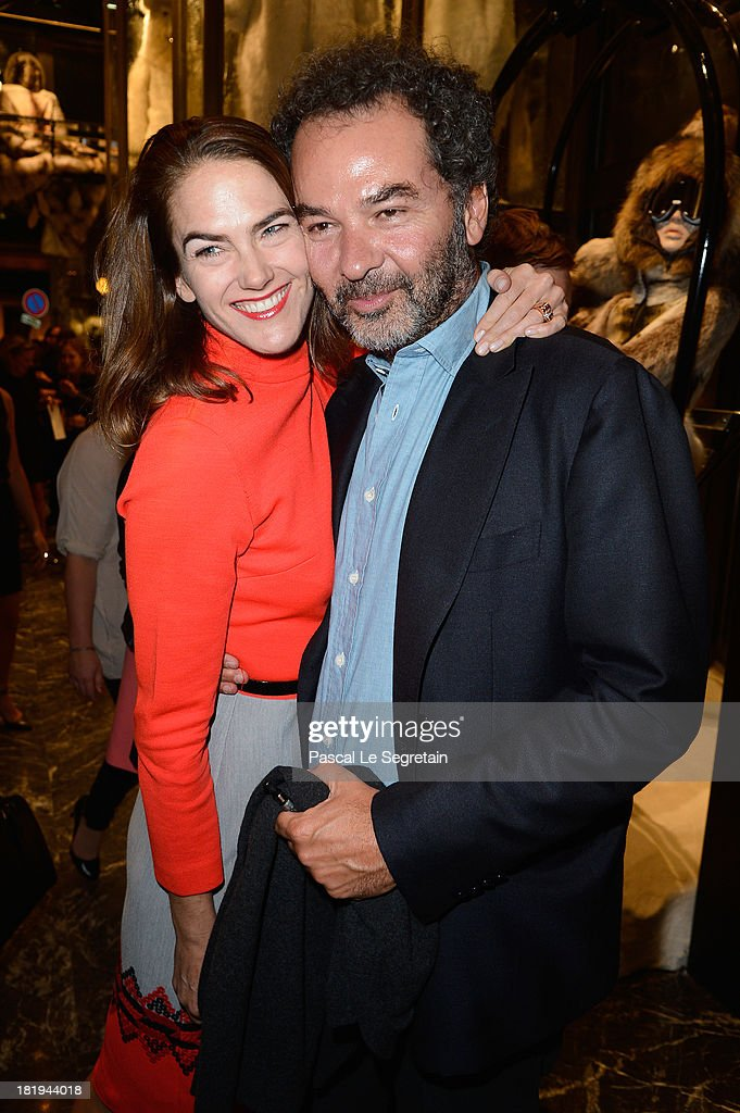Moncler's President Remo Ruffini and guest attend the cocktail for the Moncler New Flagship Opening in Paris at Rue Du Faubourg Saint-Honore on September 26, 2013 in Paris, France.