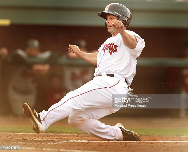 Monday April 16 2012 Sea Dogs vs New Britain Rock Cats at Hadlock Stadium Sea Dog Dan Butler slides into home plate to score Portland's first run in...