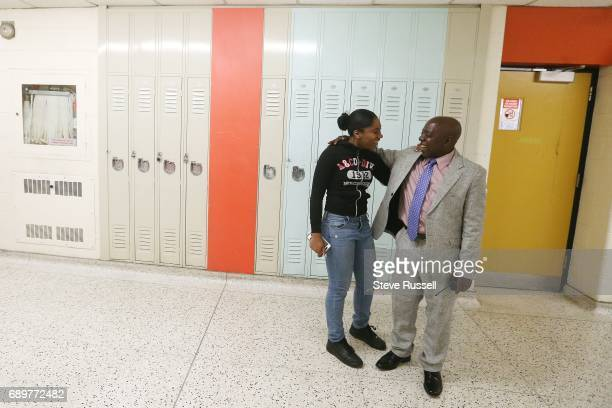 TORONTO ON APRIL 11 Monday Gala walks the halls greeting students and making sure they are where they are supposed to be As principal of CW Jefferys...