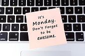 Monday inspirational greeting - Its Monday, don't forget to be awesome written on stick on paper on top of laptop keyboard