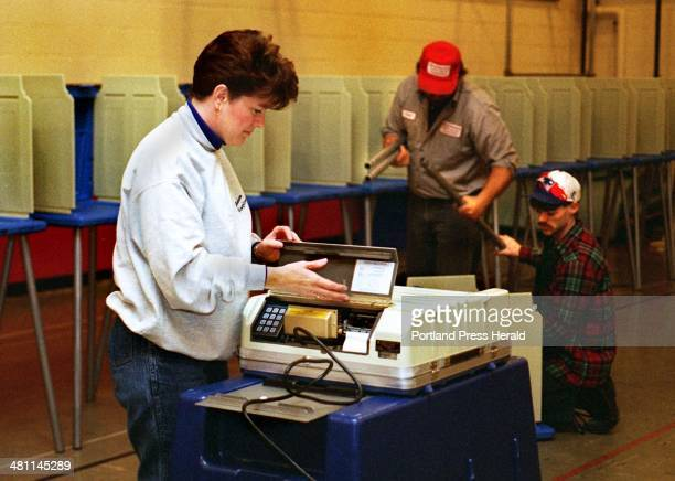 CHIBROSKI Monday November 4 1996 Deborah Cabana Brunswick Town Clerk sets up the automatic ballot counter as Chan Given and Bobby Rogers employees of...