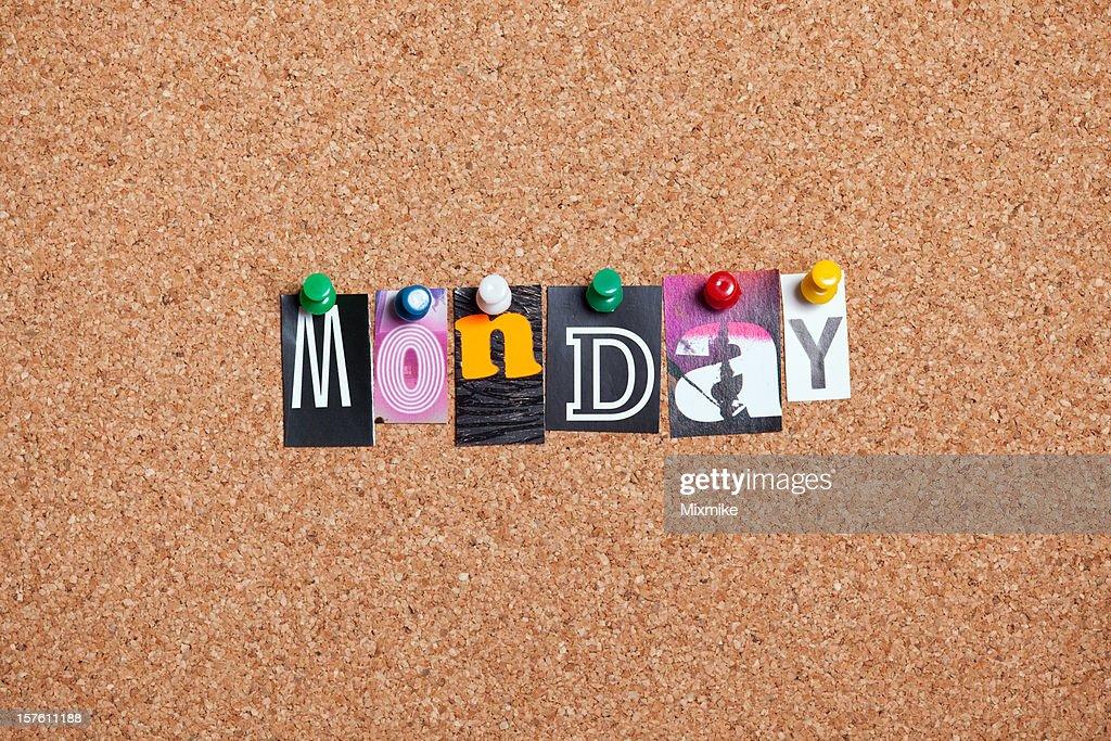 Monday pinned on bulletin cork board