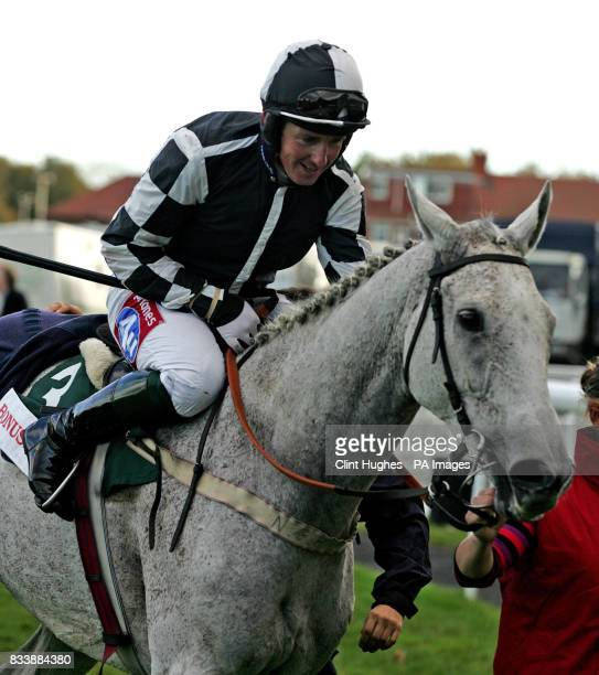 Monet's Garden gets a pat from jockey Tony Dobbin after winning The BonusprintCom Old Roan Steeple Chase at Aintree Racecourse