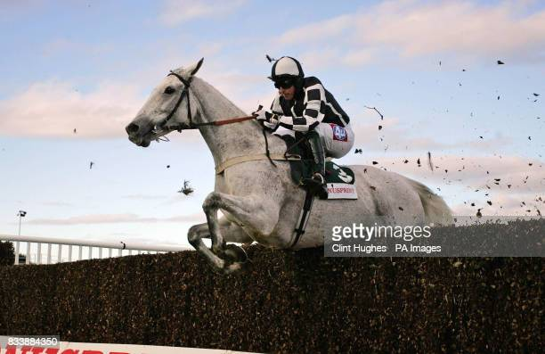Monet's Garden ridden by Tony Dobbin clears a fence on his way to winning The BonusprintCom Old Roan Steeple Chase at Aintree Racecourse