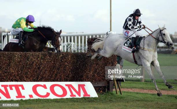 Monet's Garden ridden by Tony Dobbin clears the last fence ahead of Kauto Star to win The BonusprintCom Old Roan Steeple Chase at Aintree Racecourse