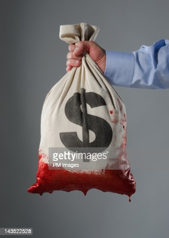 Money bag dipped in blood : Stock Photo