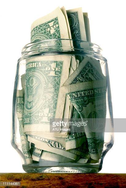 Money bills in jar