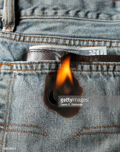 Money burning a hole in pocket, vertical