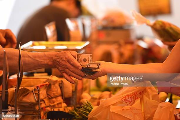 Money changing hands Union Square Park greenmarket is one of New York City's largest and oldest dating back to 1976