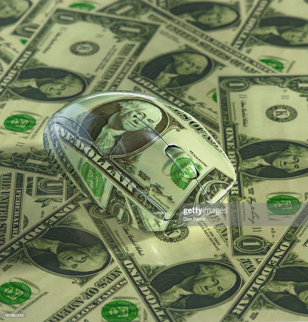 Money covered Mouse : Stock Photo