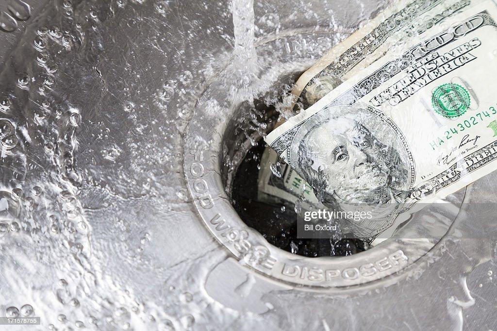 Money Down Drain : Stock Photo