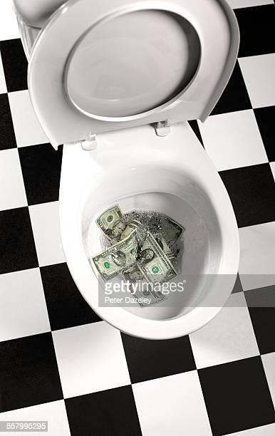 US $ money down the drain