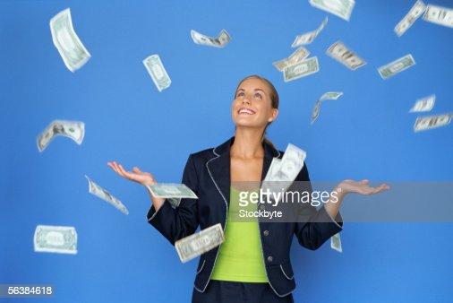 money falling around a businesswoman : Stock Photo