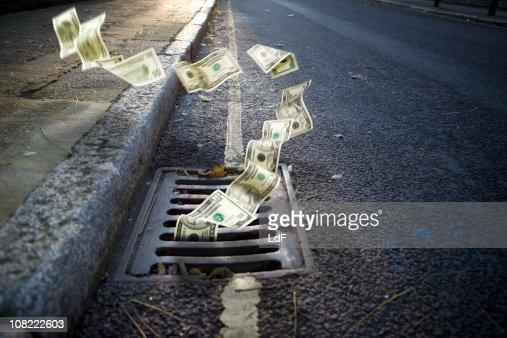 Money falling in a manhole