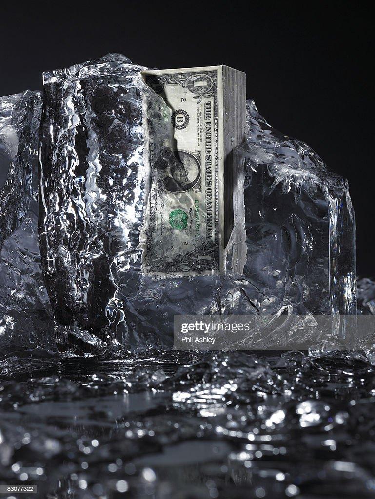 money frozen in ice, ice melting : Stock Photo