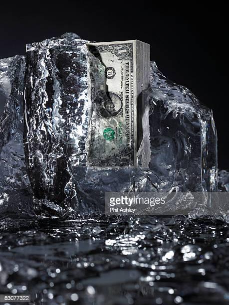 money frozen in ice, ice melting