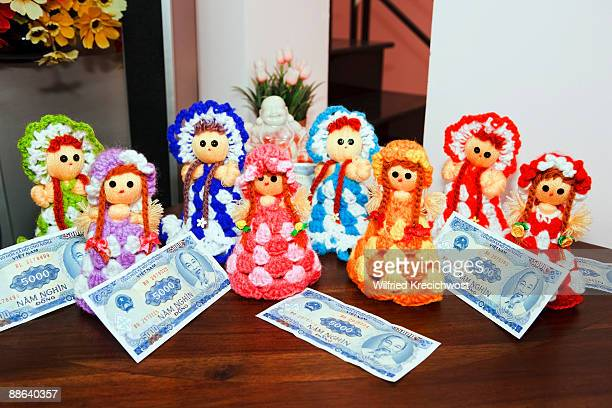money gift and traditional puppets, Tet festival