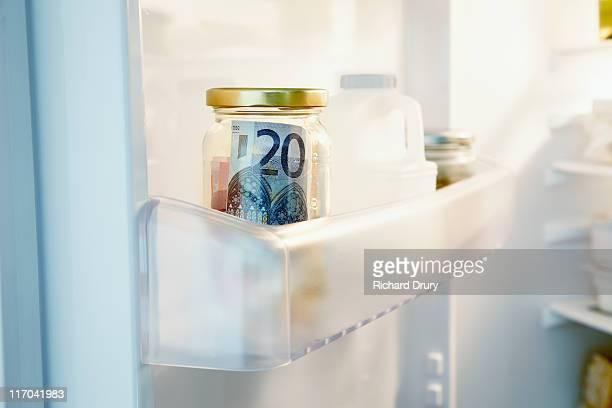 Money hidden in jar in fridge