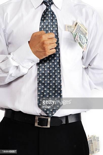 Money in a businessman's pocket