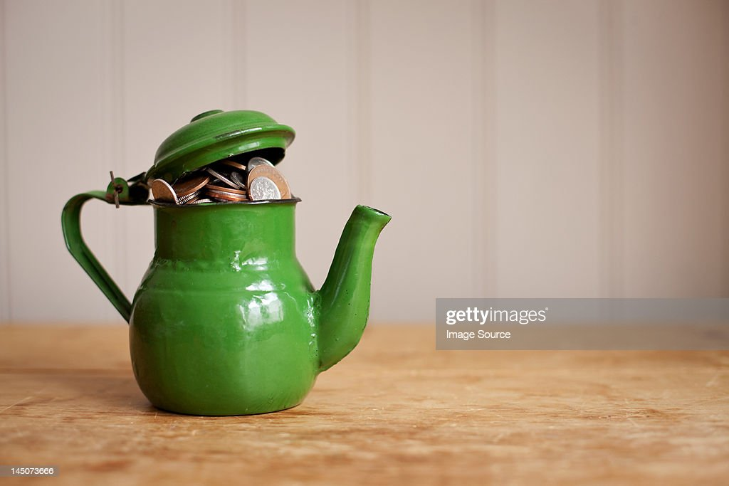 Money in a teapot : Stock Photo