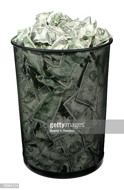 Money in a wastepaper basket