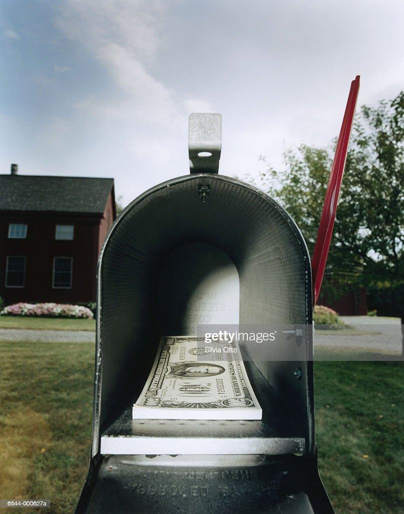 Money in Mailbox : Stock Photo