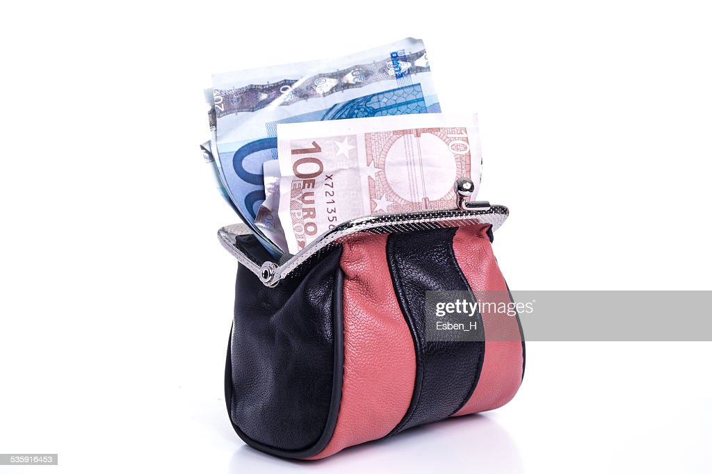 Dinheiro na Bolsa de Mão : Foto de stock