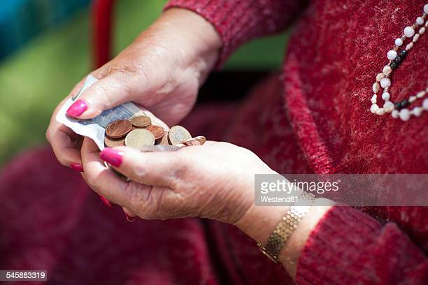Money in senior womans hands