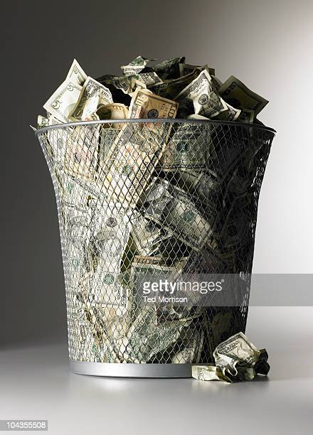 Money in the garbage can.