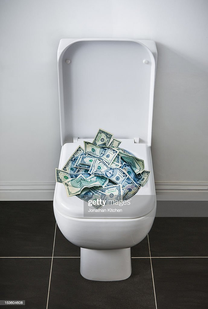 Money in the Toilet : Stock Photo