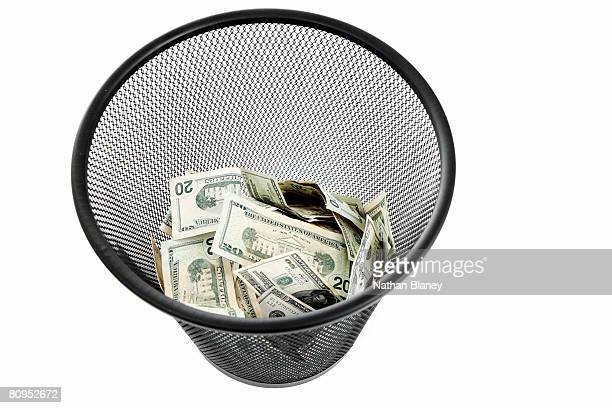 Money in the trash can.