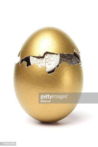 Money inside of Cracked Gold Egg on White Background
