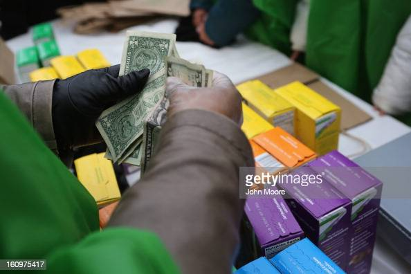 MOney is collected as Girl Scouts sell cookies while a winter storm moves in on February 8 2013 in New York City The scouts did brisk business...
