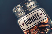 Money jar filled with cash for charitable cause