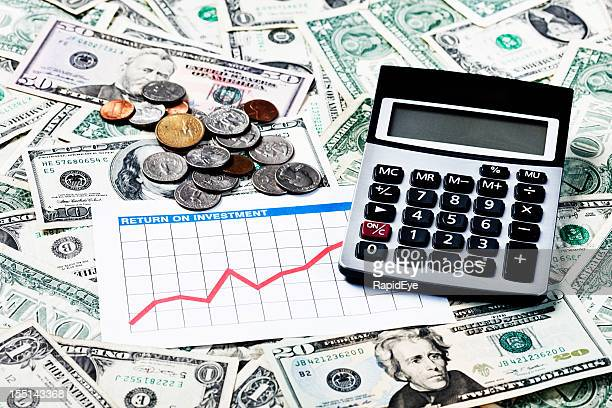 Money matters looking good: rising graph dollars and calculator